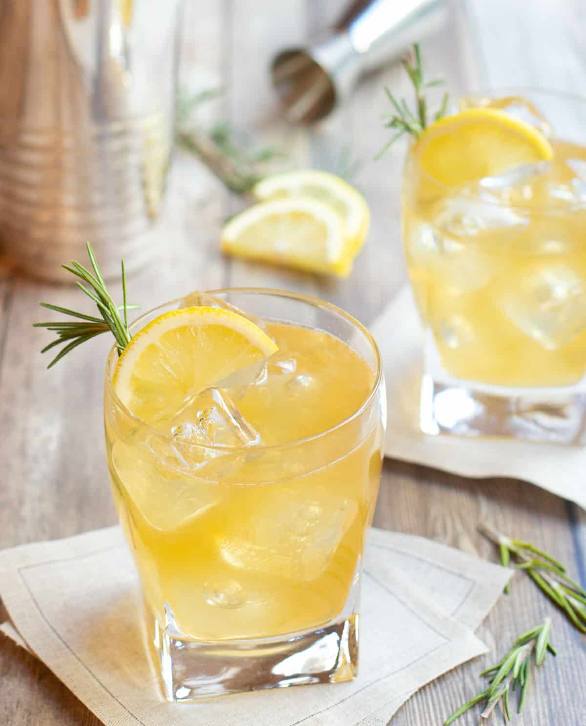 Lemon Ginger Bourbon Cocktail in a glass with a slice of lemon