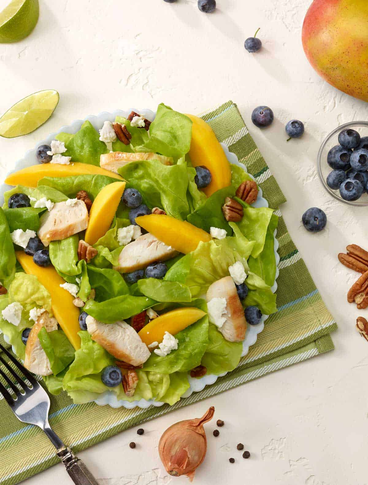 white plate filled with Chicken, Blueberry and Mango Salad