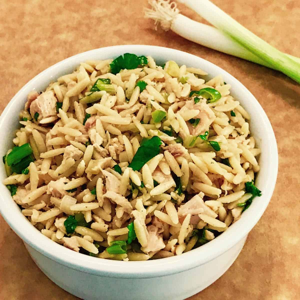 White bowl filled with Chicken and Orzo Salad with Peanut Dressing