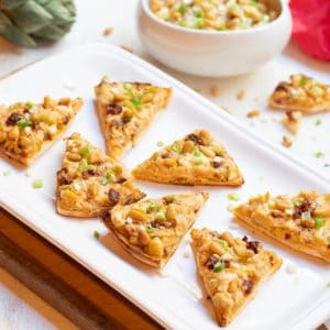 artichoke, sundried tomato and feta triangles on platter