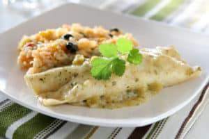 white plate with Chicken Enchiladas Suizas