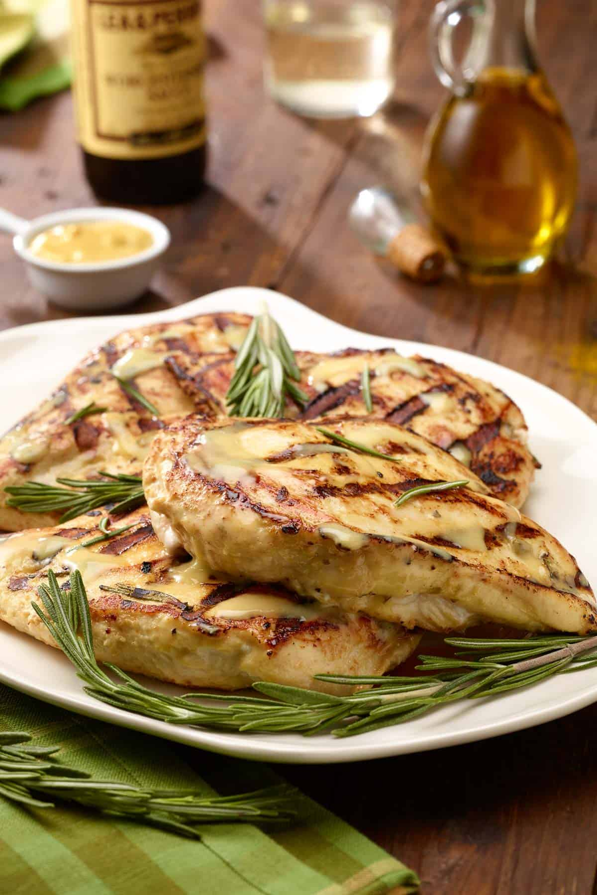 white plate with Grilled Rosemary-Dijon Chicken Breassts