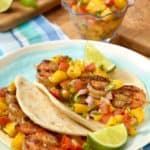 Plate with two Grilled Shrimp Tacos with Tomato-Mango Salsa