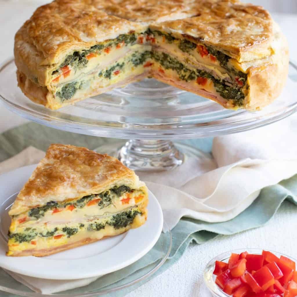 Ham, Cheese and Spinach Torte with piece in front
