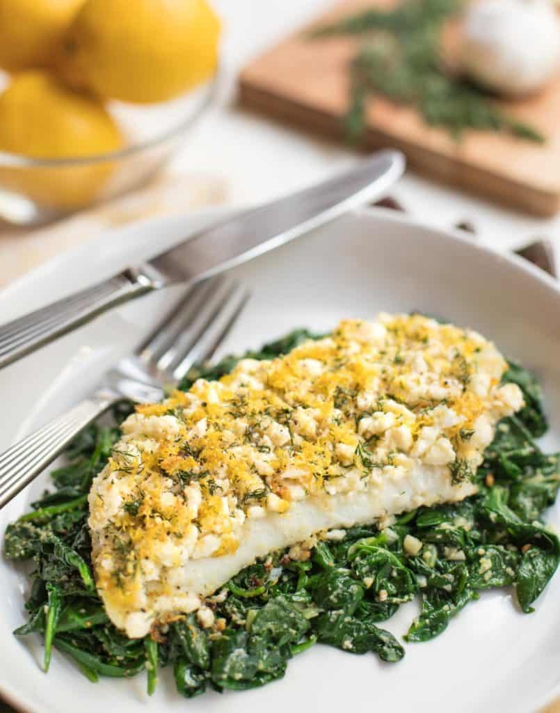 Roasted-Cod-Fillets-topped-with-feta-lemon-dill-over-spinach-www.seasonedkitchen.com