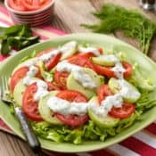 Sliced tomatoes and cucumbers with yogurt-mint dressing