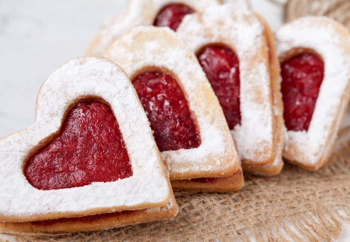 Heart-shaped Almond Cookies filled with Raspberry jam