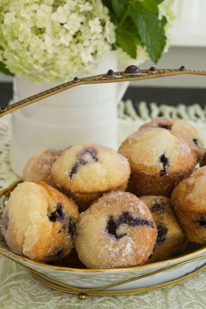 White and gold basket holding Blueberry Lemon Muffins