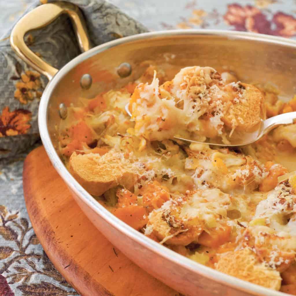 Copper gratin dish filled with Butternut Squash Gratin