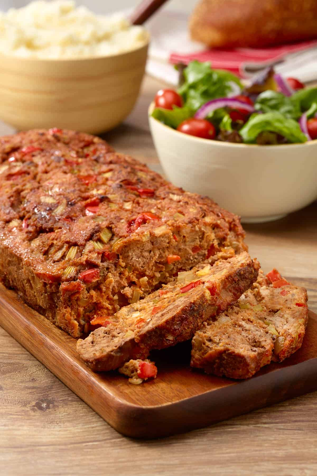 cutting board with sliced Cajun Meatloaf