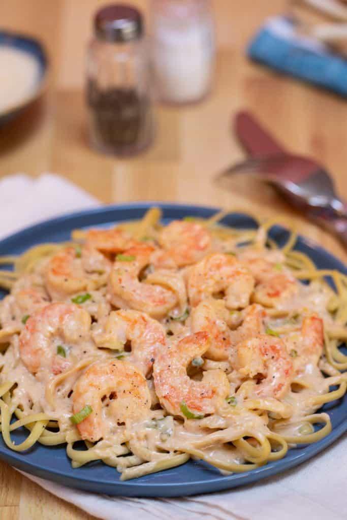 Blue plate filled with Cajun Shrimp Linguine