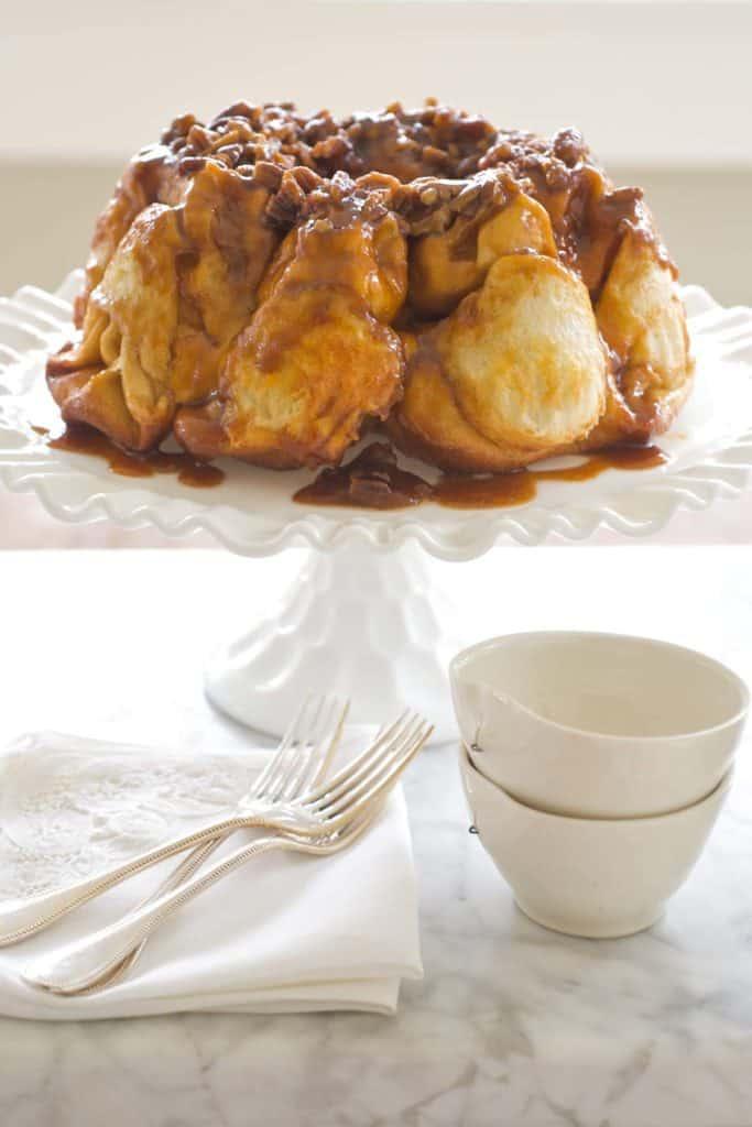 White cake pan holding Overnight Bundt Caramel Rolls