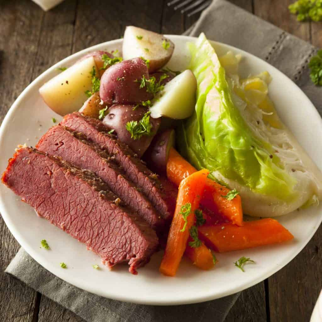 white plate with Mom's Corned Beef and Cabbage