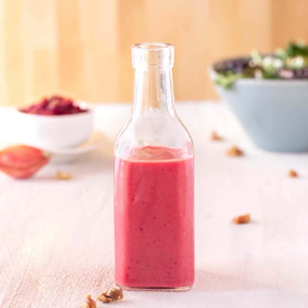 Clear glass bottle showing Cranberry Vinaigrette