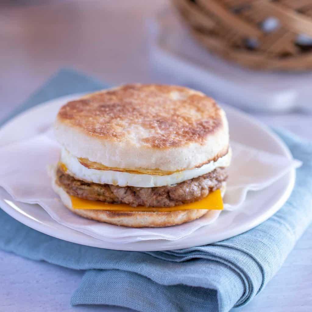 White plate showing a make ahead Egg Breakfast Sandwich