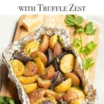 Foil packet filled with grilled new potatoes, seasoned with Parmesan Cheese, parsley and truffle zest.