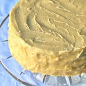 glass cake sand holding Jam Cake with Caramel Frosting