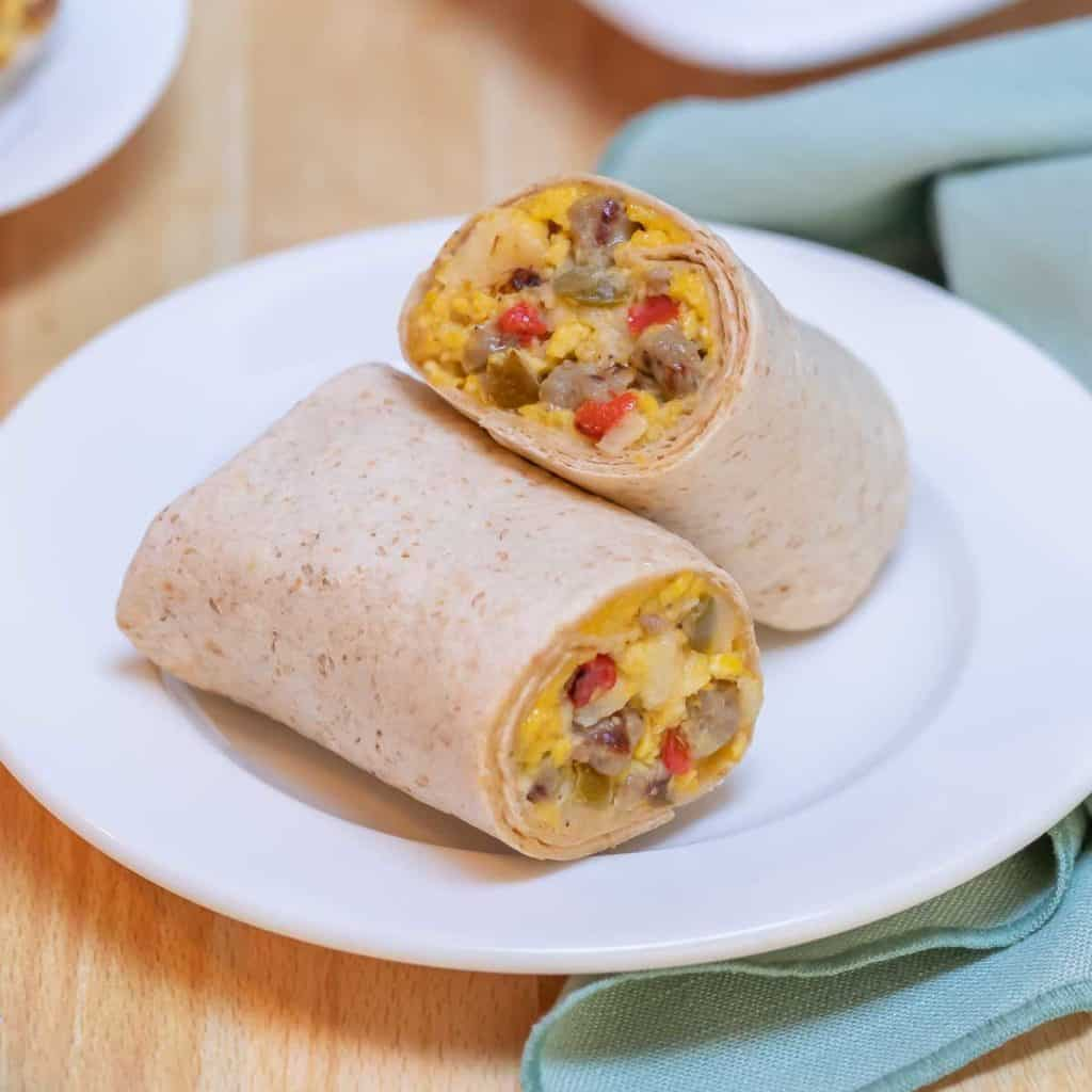 Close up of single Make Ahead Breakfast Burritos, cut in half to show inside