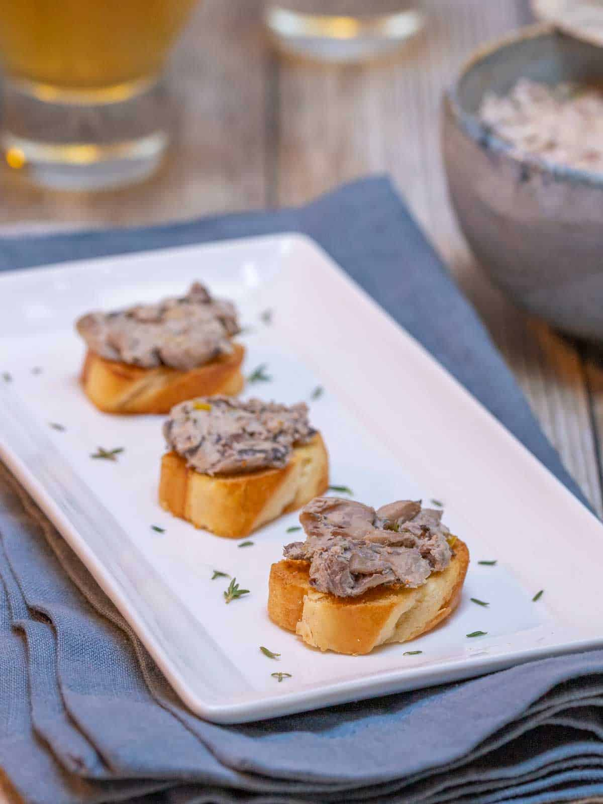white serving platter showing three servings of Mushroom Pâté