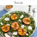 White round shallow bowl filled with Grilled Peach and Fresh Mozzarella Cheese Salad