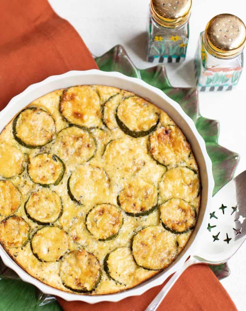 Round baking dish with a zucchini custard