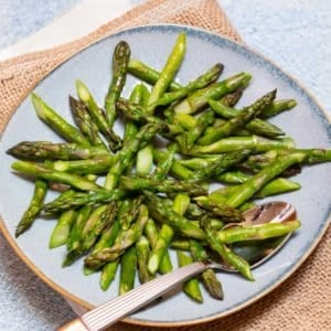 Blue plate filled with Quick and Easy Sauteed Asparagus