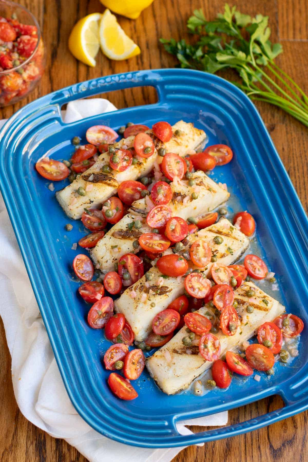 Blue platter with Sea Bass and Tomatoes in a Lemon-Butter Sauce