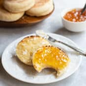 Sliced toasted english muffin with orange marmalade