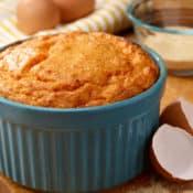 Blue souffle dish filled with Brandied Sweet Potato Souffle