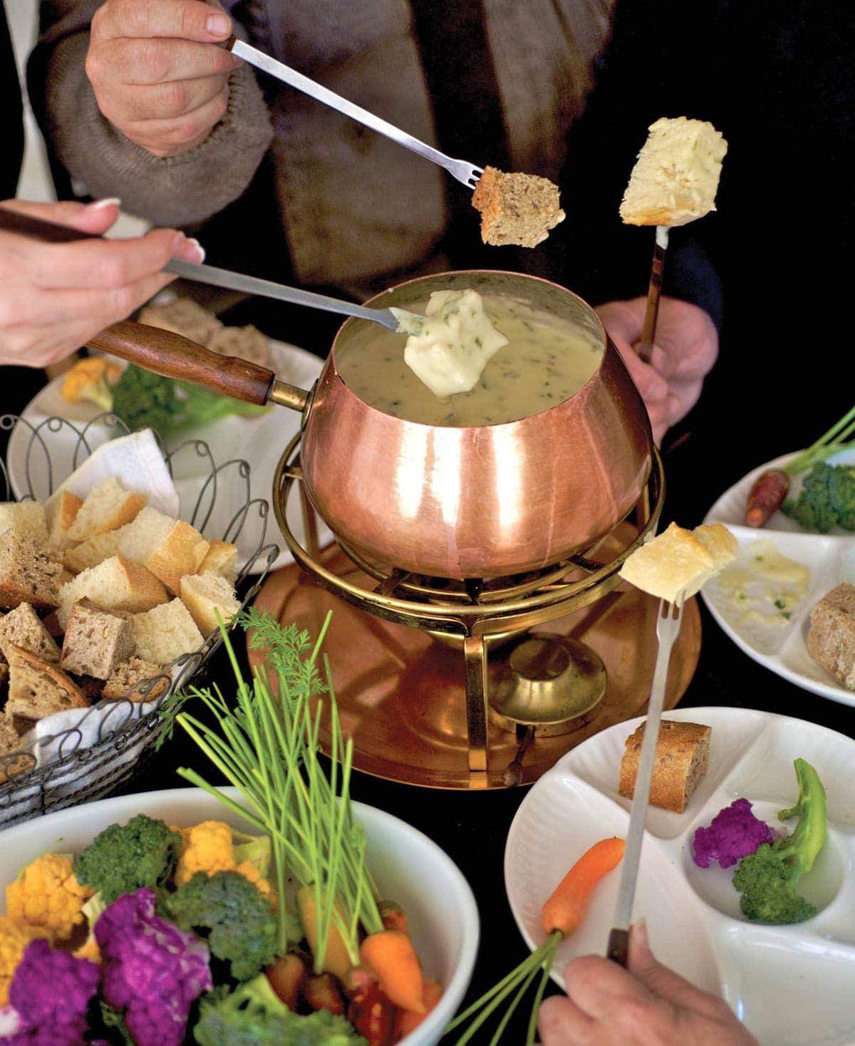Copper fondue pot filled with Tex Mex Fondue