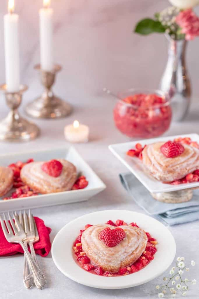 Three plates each holding a single Valentine's Mini Cake, with strawberry almond salsa on the side