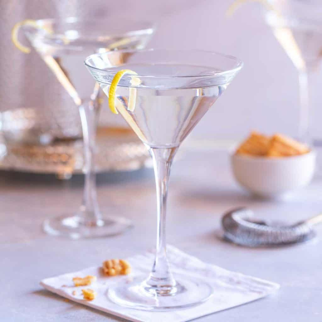 two martini glasses filled with Vodka Martini with a Twist