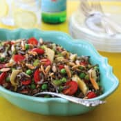 Oval blue bowl filled with Elegant Wild Rice Salad with Parmesan Vinaigrette