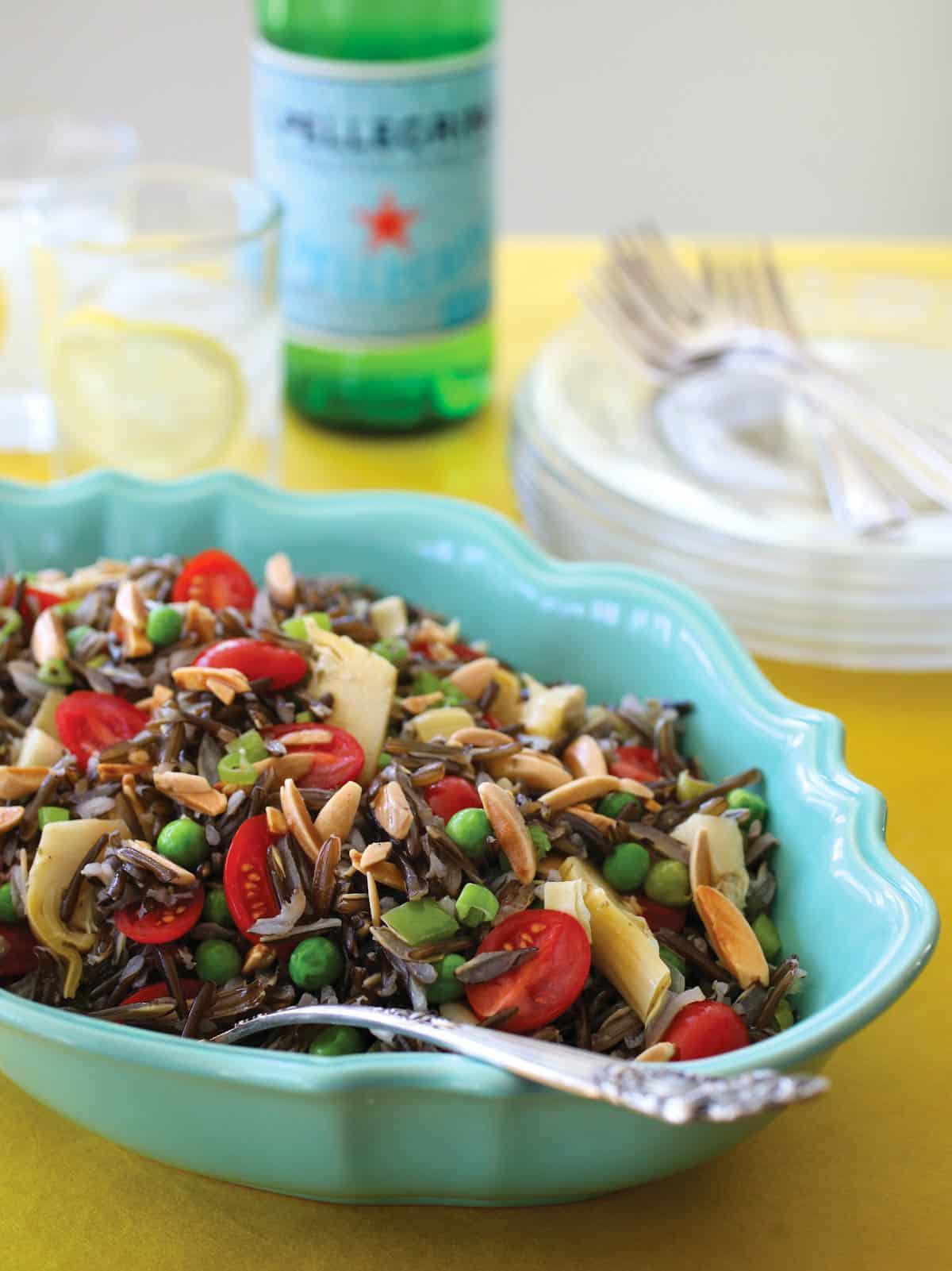 Oval blue bowl filled with Elegant Wild Rice Salad with Parmesan Vinaigrette